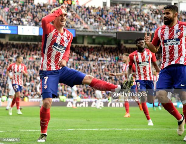 Atletico Madrid's French forward Antoine Griezmann celebrates a goal during the Spanish league football match between Real Madrid CF and Club...