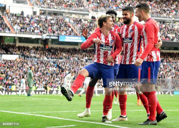 Atletico Madrid's French forward Antoine Griezmann celebrates a goal with teammates during the Spanish league football match between Real Madrid CF...