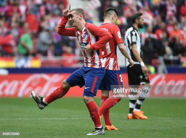 Atletico Madrid's French forward Antoine Griezmann celebrates a goal during the Spanish league football match between Club Atletico de Madrid and...