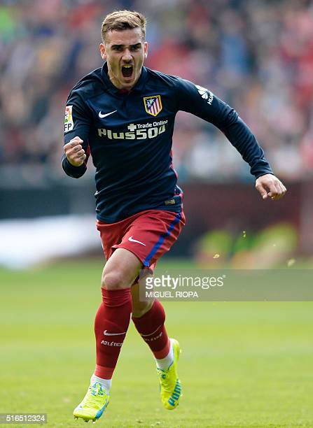 Atletico Madrid's French forward Antoine Griezmann celebrates after scoring a goal during the Spanish league football match Real Sporting de Gijon vs...