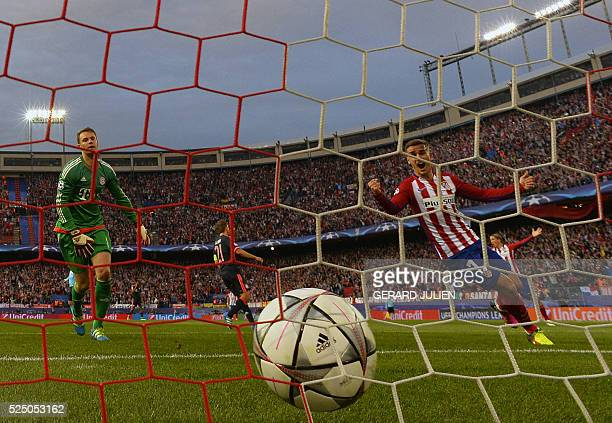 TOPSHOT Atletico Madrid's French forward Antoine Griezmann celebrates after a goal beside Bayern Munich's goalkeeper Manuel Neuer during the UEFA...