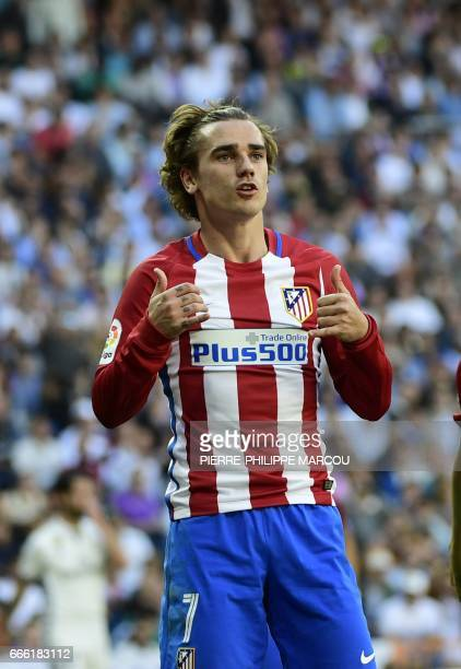 Atletico Madrid's French forward Antoine Griezmann celebrates after scoring a goal during the Spanish league football match Real Madrid CF vs Club...