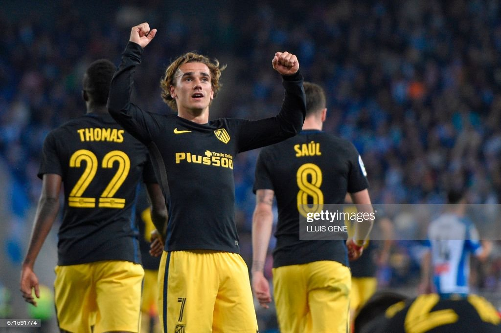 Atletico Madrid's French forward Antoine Griezmann celebrates after scoring a goal during the Spanish league football match RCD Espanyol vs Club Atletico de Madrid at the RCDE Stadium in Cornella de Llobregat on April 22, 2017. /