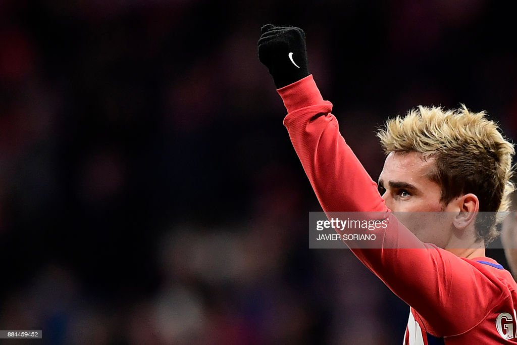 Atletico Madrid's French forward Antoine Griezmann celebrates after scoring a goal during the Spanish league football match Club Atletico de Madrid vs Real Sociedad at the Wanda Metropolitano stadium in Madrid on December 2, 2017. /