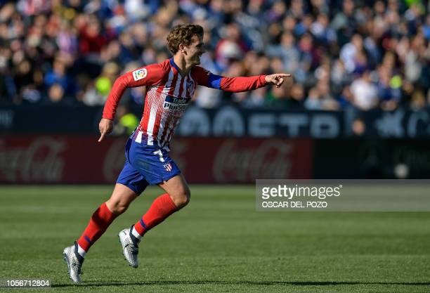 Atletico Madrid's French forward Antoine Griezmann celebrates after scoring the opening goal during the Spanish league football match between Club...