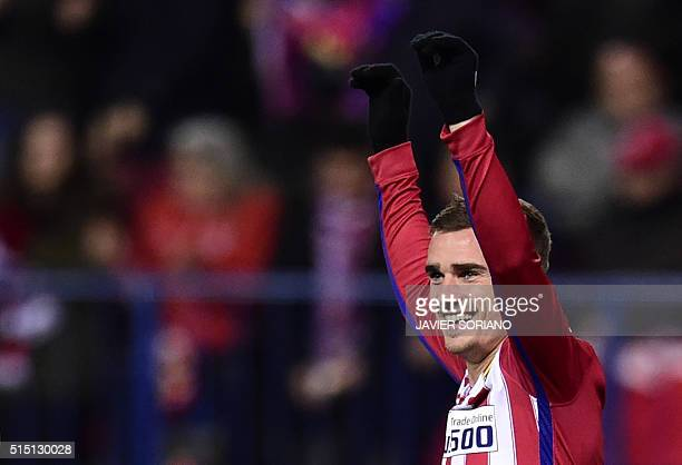 Atletico Madrid's French forward Antoine Griezmann celebrates after scoring during the Spanish league football match Club Atletico de Madrid vs RC...