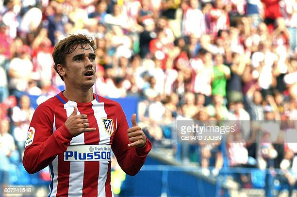 Atletico Madrid's French forward Antoine Griezmann celebrates after scoring during the Spanish league football match Club Atletico de Madrid vs Real...