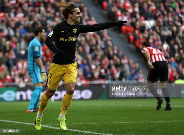 Atletico Madrid's French forward Antoine Griezmann celebrates after scoring during the Spanish league football match Athletic Club Bilbao vs Club...