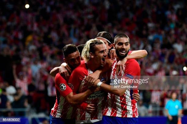 Atletico Madrid's French forward Antoine Griezmann celebrates after scoring during the UEFA Champions League Group C football match Club Atletico de...
