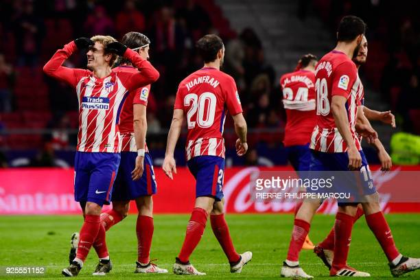 Atletico Madrid's French forward Antoine Griezmann celebrates his second goal during the Spanish league football match Club Atletico de Madrid...