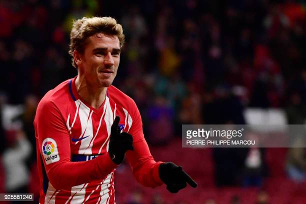Atletico Madrid's French forward Antoine Griezmann celebrates his third goal during the Spanish league football match Club Atletico de Madrid against...