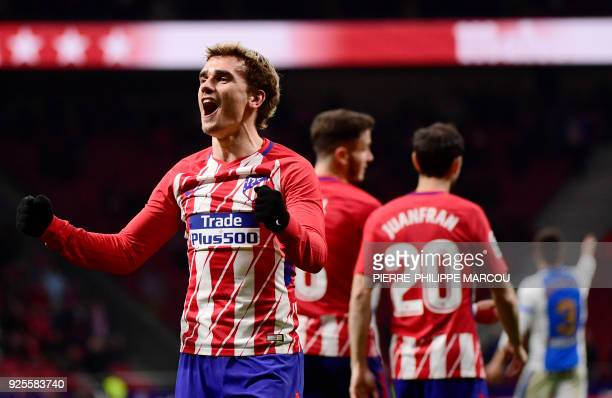 TOPSHOT Atletico Madrid's French forward Antoine Griezmann celebrates his third goal during the Spanish league football match Club Atletico de Madrid...