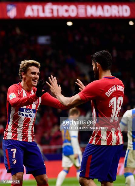 Atletico Madrid's French forward Antoine Griezmann celebrates his fourth goal with Atletico Madrid's Spanish forward Diego Costa during the Spanish...