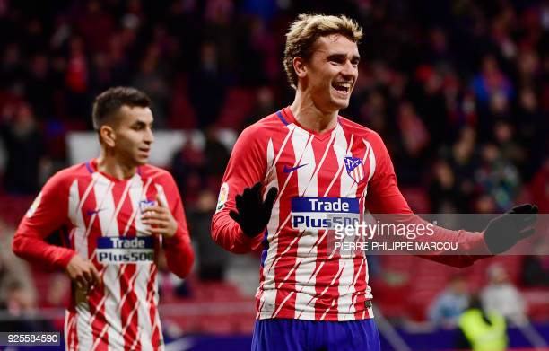 TOPSHOT Atletico Madrid's French forward Antoine Griezmann celebrates his fourth goal during the Spanish league football match Club Atletico de...