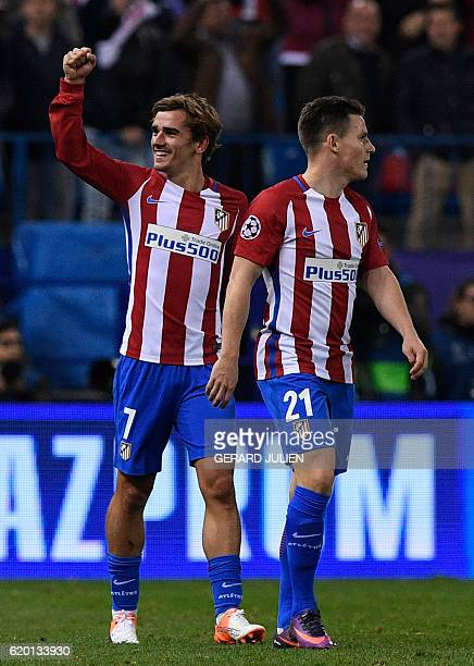 Atletico Madrid's French forward Antoine Griezmann celebrates past Atletico Madrid's French forward Kevin Gameiro after scoring a second goal during...