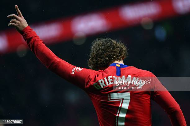 TOPSHOT Atletico Madrid's French forward Antoine Griezmann celebrates scoring a goal during the Spanish league football match between Club Atletico...