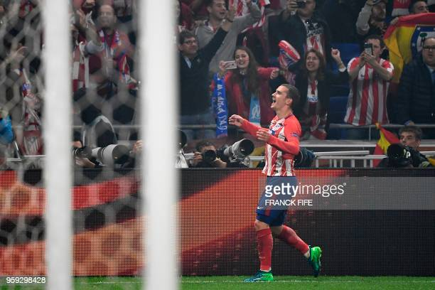 Atletico Madrid's French forward Antoine Griezmann celebrates scoring the opening goal during the UEFA Europa League final football match between...