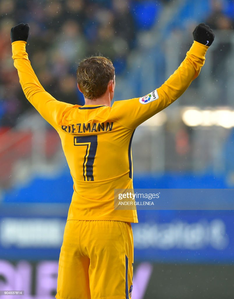 Atletico Madrid's French forward Antoine Griezmann celebrates teammate French forward Kevin Gameiro's goal during the Spanish league football match between SD Eibar and Club Atletico de Madrid at the Ipurua stadium in Eibar on January 13, 2018. /