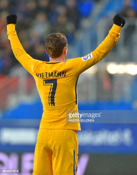 Atletico Madrid's French forward Antoine Griezmann celebrates teammate French forward Kevin Gameiro's goal during the Spanish league football match...