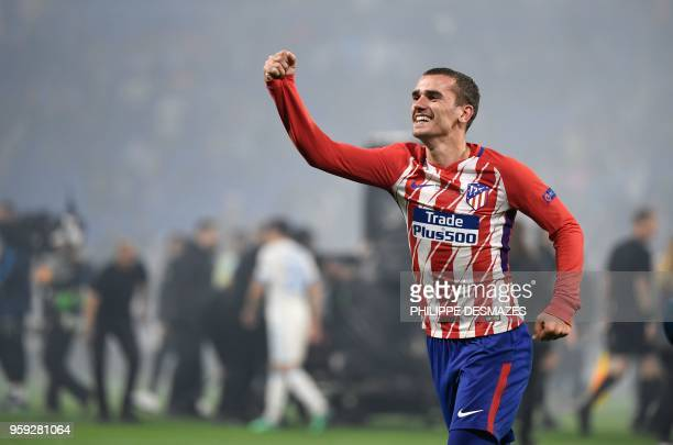 Atletico Madrid's French forward Antoine Griezmann celebrates their victory after winning the UEFA Europa League final football match between...