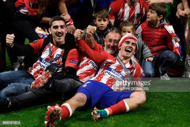 TOPSHOT Atletico Madrid's French forward Antoine Griezmann celebrates their victory with his father Alain Griezmann after winning the UEFA Europa...