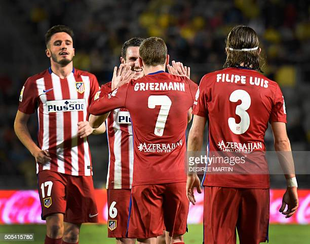 Atletico Madrid's French forward Antoine Griezmann celebrates with teammates after scoring during the Spanish league football match UD Las Palmas vs...
