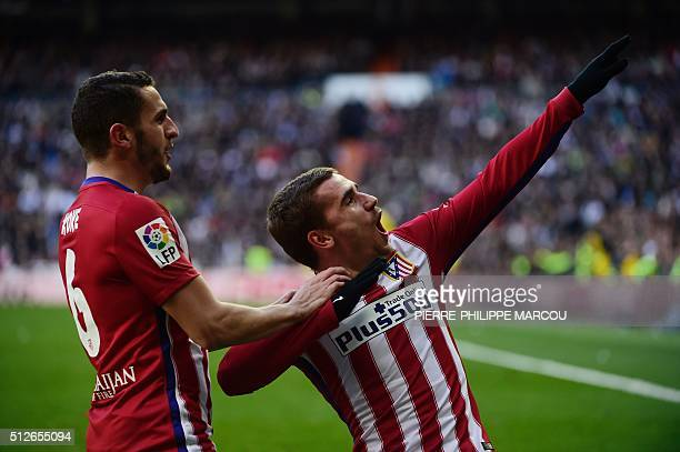 Atletico Madrid's French forward Antoine Griezmann celebrates with Atletico Madrid's midfielder Koke after scoring during the Spanish league football...