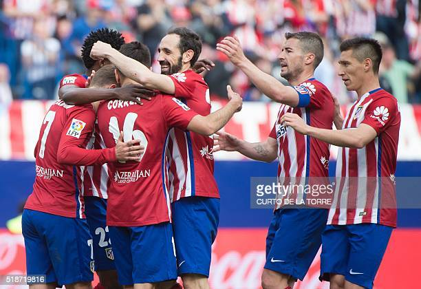 Atletico Madrid's French forward Antoine Griezmann celebrates with teammates after scoring during the Spanish league football match Club Atletico de...