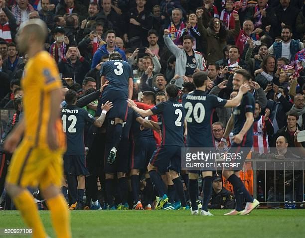 Atletico Madrid's French forward Antoine Griezmann celebrates with teammates after scoring during the Champions League quarterfinal second leg...