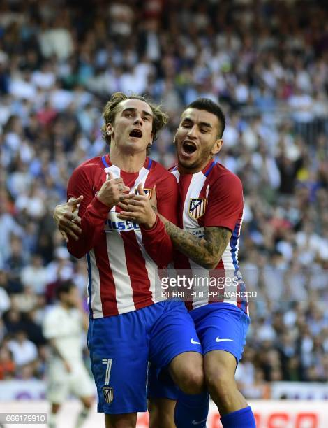 Atletico Madrid's French forward Antoine Griezmann celebrates with Atletico Madrid's Argentinian midfielder Angel Correa after scoring a goal during...