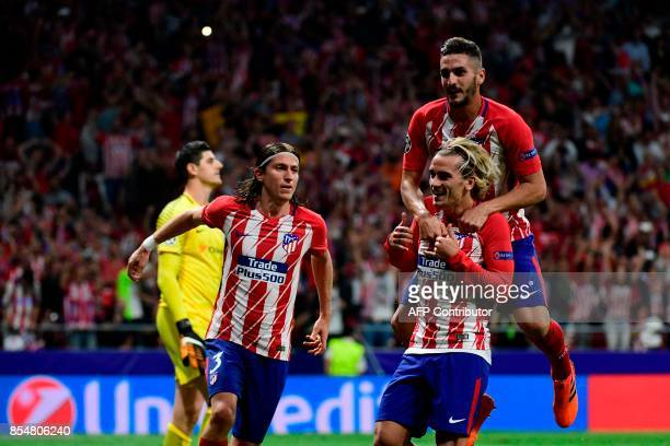 Atletico Madrid's French forward Antoine Griezmann celebrates with teammates after scoring during the UEFA Champions League Group C football match...