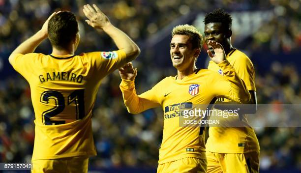 Atletico Madrid's French forward Antoine Griezmann celebrates with Atletico Madrid's French forward Kevin Gameiro after scoring during the Spanish...