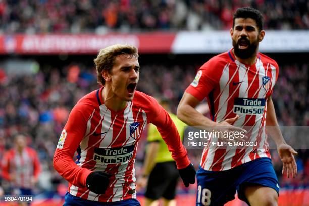 Atletico Madrid's French forward Antoine Griezmann celebrates with Atletico Madrid's Spanish forward Diego Costa after scoring a goal during the...