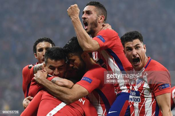 TOPSHOT Atletico Madrid's French forward Antoine Griezmann celebrates with Atletico Madrid's Spanish forward Diego Costa Atletico Madrid's Spanish...