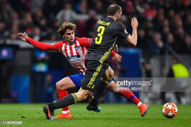 Atletico Madrid's French forward Antoine Griezmann challenges Juventus' Italian defender Giorgio Chiellini during the UEFA Champions League round of...