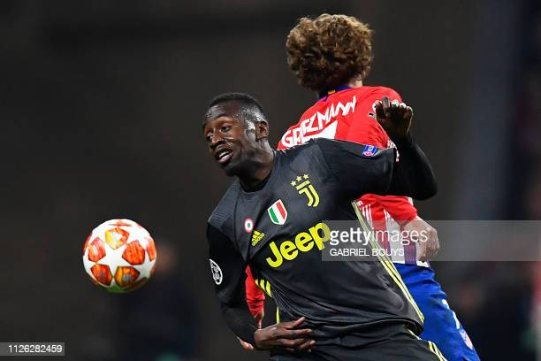 TOPSHOT Atletico Madrid's French forward Antoine Griezmann challenges Juventus' French midfielder Blaise Matuidi during the UEFA Champions League...