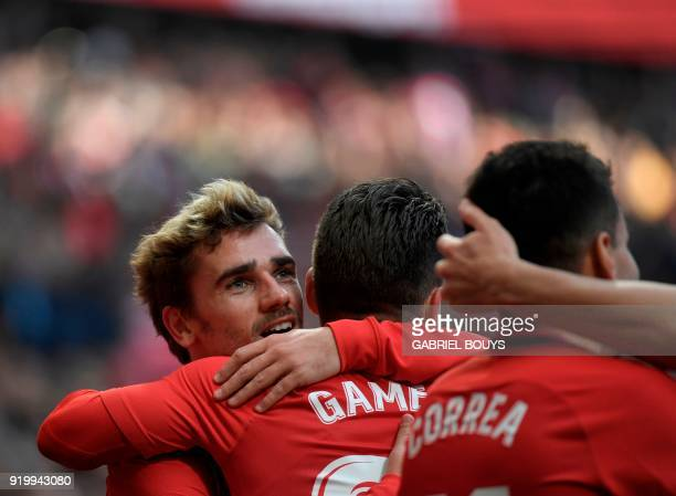 Atletico Madrid's French forward Antoine Griezmann congratulates Atletico Madrid's French forward Kevin Gameiro for his goal during the Spanish...
