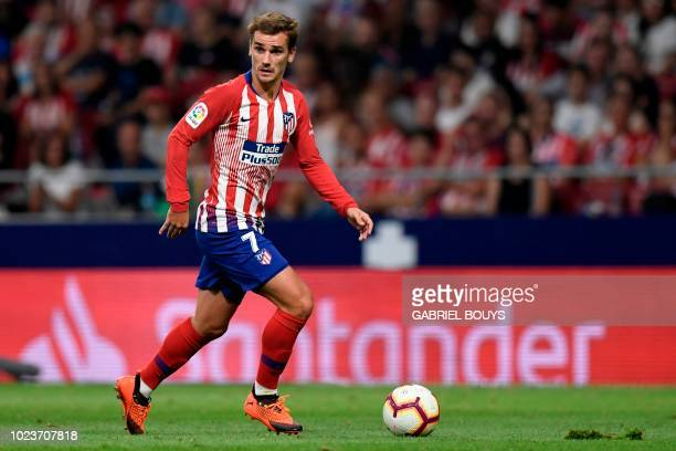 Atletico Madrid's French forward Antoine Griezmann controls the ball during the Spanish league football match between Club Atletico de Madrid and...