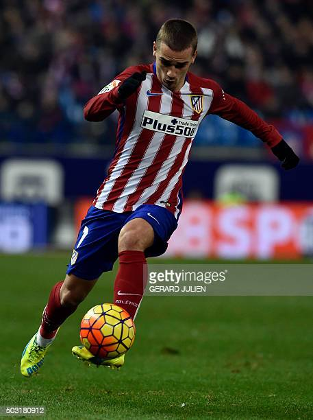Atletico Madrid's French forward Antoine Griezmann controls the ball during the Spanish league football match Club Atletico de Madrid vs Levante UD...