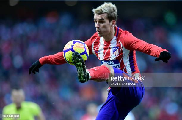 Atletico Madrid's French forward Antoine Griezmann controls the ball during the Spanish league football match Club Atletico de Madrid vs Real...