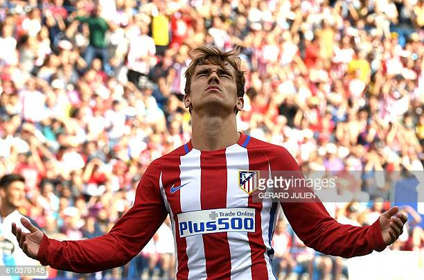 Atletico Madrid's French forward Antoine Griezmann gestures after missing a goal opportunity during the Spanish league football match Club Atletico...
