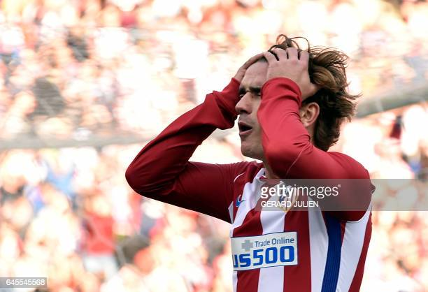 TOPSHOT Atletico Madrid's French forward Antoine Griezmann gestures after missing a goal during the Spanish league football match Club Atletico de...