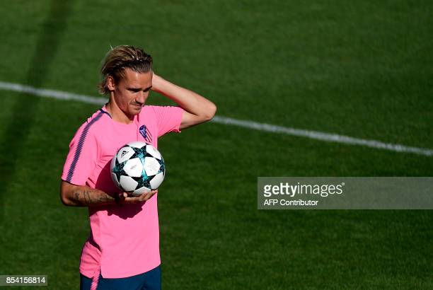Atletico Madrid's French forward Antoine Griezmann gestures during a training session at the Wanda Metropolitano stadium in Madrid on September 26...