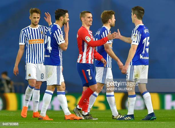 Atletico Madrid's French forward Antoine Griezmann greets Real Sociedad's Spanish defender Aritz Elustondo at the end of the Spanish league football...