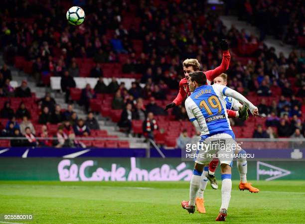 Atletico Madrid's French forward Antoine Griezmann heads he ball to score a hattrick during the Spanish league football match Club Atletico de Madrid...