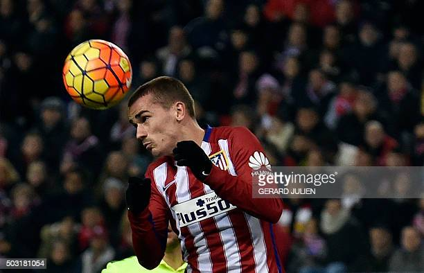 Atletico Madrid's French forward Antoine Griezmann heads the ball during the Spanish league football match Club Atletico de Madrid vs Levante UD at...