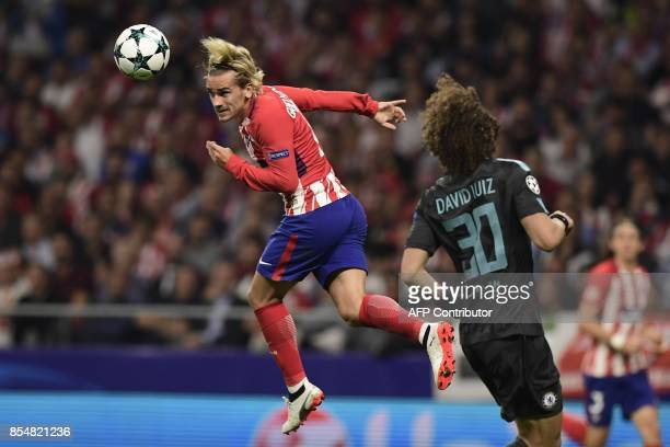 Atletico Madrid's French forward Antoine Griezmann heads the ball during the UEFA Champions League Group C football match Club Atletico de Madrid vs...