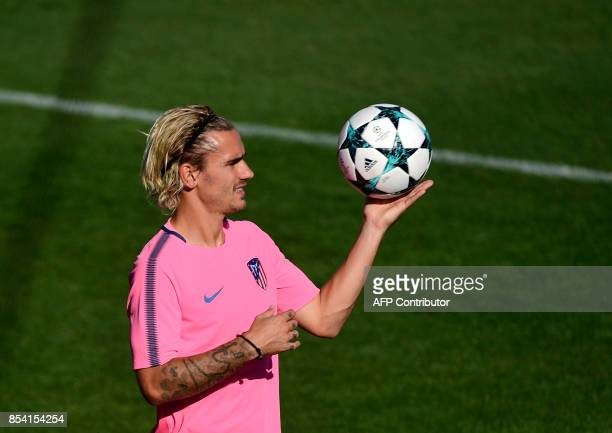 Atletico Madrid's French forward Antoine Griezmann holds a ball during a training session at the Wanda Metropolitano stadium in Madrid on September...
