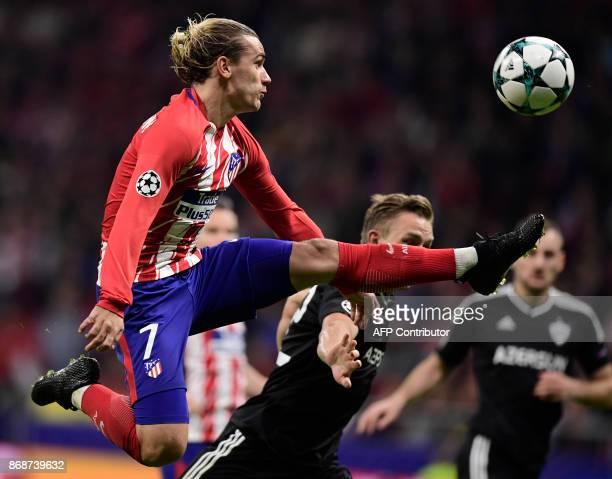 Atletico Madrid's French forward Antoine Griezmann kicks the ball during the UEFA Champions League football match Club Atletico de Madrid vs Qarabag...