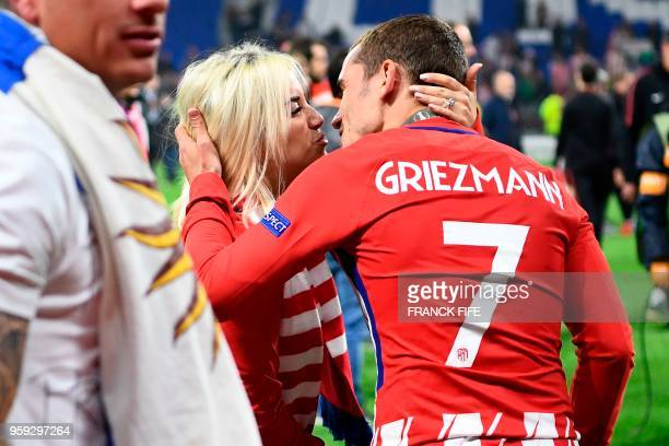 Atletico Madrid's French forward Antoine Griezmann kisses his wife Erika Choperana after the UEFA Europa League final football match between...